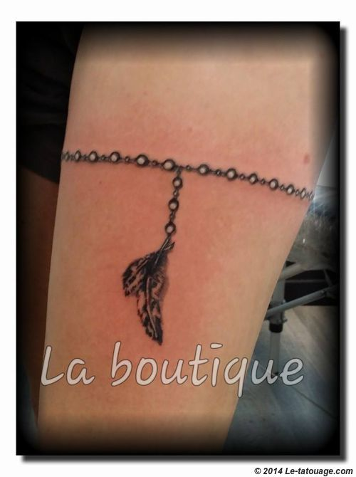 tatouage bracelet poignet femme plume. Black Bedroom Furniture Sets. Home Design Ideas